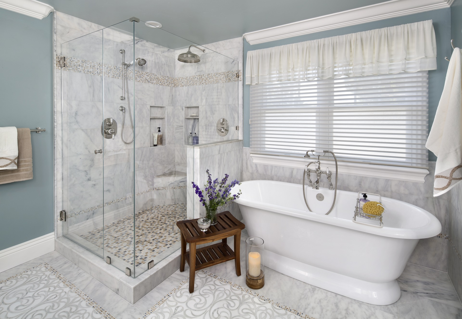 the glass enclosed shower and freestanding tub for the master bathroom remodel by valley home